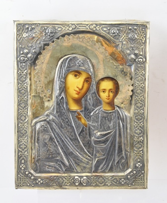 A 20TH CENTURY RUSSIAN OR POLISH ICON MADONNA AND CHILD, painted on a wooden panel, overlaid with an embossed yellow and white metal riza, velvet backed, 22cm x 18cm
