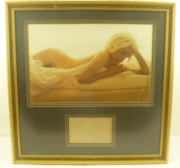 MARILYN MONROE (1926 - 1962) A colour studio portrait, in the nude, mounted with an autograph below, personalized inscription To Ruth love and kisses Marilyn Monroe, in gilt frame, mounted and glazed, main image 26cm x 41cm