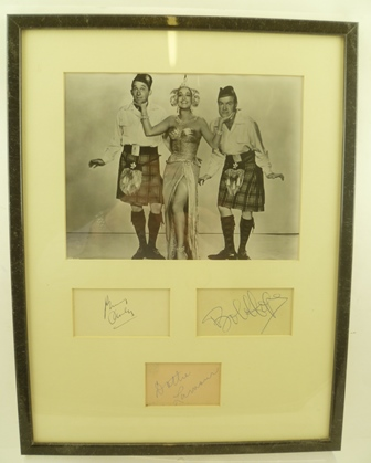 ROAD TO BALI, 1952 Black and white studio portrait of the three main characters in costume, Bob Hope (1903 - 2003), Bing Crosby (1903 . 1977) and Dorothy Lamour (1914 - 1996), mounted with three separate autographs below, in ebonised frame, mountedand glazed, main image 19cm x 24cm