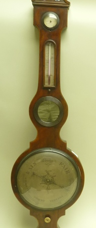 A 19TH MAHOGANY CASED BAROMETER, fitted hydrometer and thermometer, main engraved, silvered dial, 25cm diameter, the case with architectural pediment, overall height 112cm