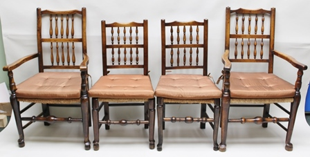 A MATCHED SET OF EIGHT PROVINCIAL SPINDLE BACK DINING CHAIRS, comprising six singles and a pair of open arm carvers, each having woven seagrass seat, with turned fore cross stretchers on pad feet