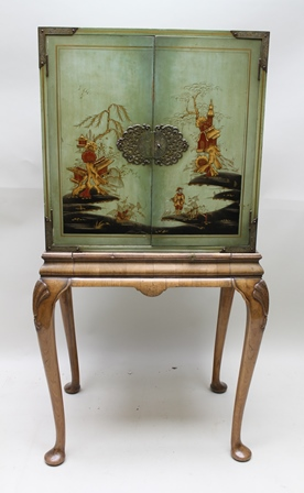 A MID 20TH CENTURY GEORGIAN DESIGN CHINOISERIE CABINET, the celadon ground with landscape and figure decoration in red, black and gold, upon a base fitted glazed slide on cabriole supports, top 61cm wide x overall height 133cm