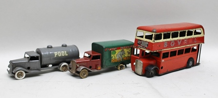 A COLLECTION OF TRIANG MINIC TIN PLATE TOYS to include, two vintage commercial vehicles, one with a pull tanker body, the other box body bearing the livery of Carter Patterson and Double Decker London Transport Bus no.177 with the remains of the Bovril advertising livery, each vehicle with clockwork motors