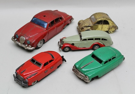 A COLLECTION OF FIVE TIN-PLATE COLLECTORS VEHICLES including friction drive Jaguar saloon, two friction driven saloons, gold coloured tin plate Citroen Diane, clockwork American road car