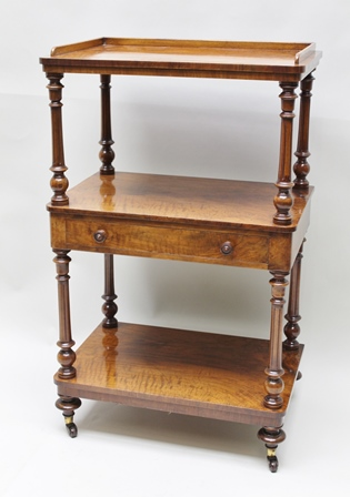 EDWARDS & ROBERTS A LATE VICTORIAN ROSEWOOD THREE-TIER WHATNOT, with plain low gallery top, middle tier fitted single drawer with knob handles, turned feet with castors, 59cm wide x 97cm high