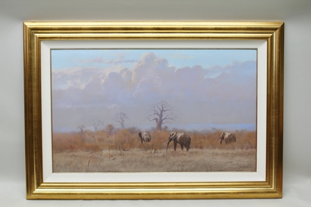 KIM DONALDSON (1952 - ) Elephants walking into the bush, Baobab trees in the distance, Pastel drawing, signed, in gilt mounted and glazed frame, 60cm x 100cm
