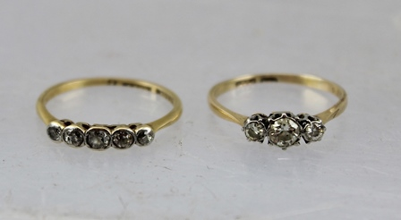 TWO DIAMOND SET LADYS DRESS RINGS, a three stone and a five stone, gold and platinum set, (three stone - size N, five stone - size O)