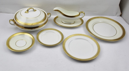 A COMPREHENSIVE AYNSLEY BONE CHINA PART DINNER SERVICE, comprising two patterns, Argosy and Sandringham, both similar, cream/white with gilded rims, comprising a pair of vegetable tureens with covers, a pair of gravy boats with stands, a pair ofoval serving dishes, 35cm, ten dinner plates, twelve dessert plates, twelve tea/side plates and eight saucers