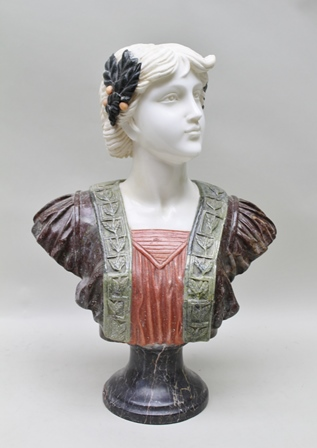 AN ART NOUVEAU MIXED MARBLE BUST OF A CLASSICAL BEAUTY, wreaths in her hair, wearing Renaissance style costume, upon black marble socle base, 59cm high