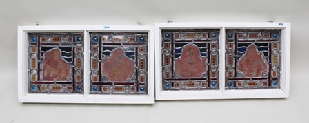 A SET OF FOUR PAINTED AND STAINED GLASS LEADED PANELS, Four Seasons, each panel with a figurative, symbolic representation, within a roundel set border, mounted in pairs in white painted frames, each panel 26cm x 25cm