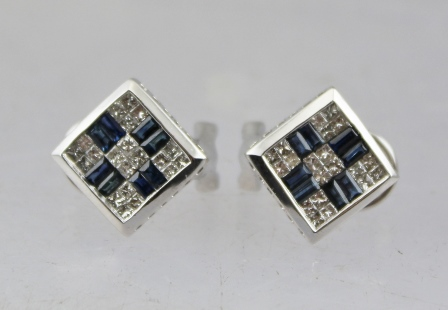 A PAIR OF 14K WHITE GOLD SAPPHIRE AND DIAMOND STUD EARRINGS, having Princess cut diamonds and baguette cut sapphires, 6g.