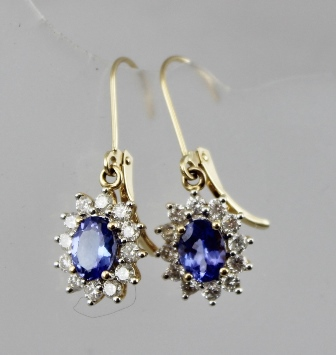 A PAIR OF TANZANITE AND DIAMOND CLUSTER EARRINGS