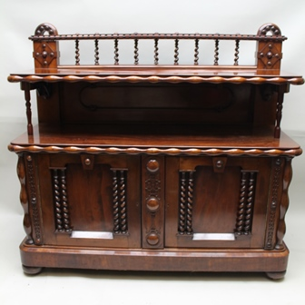 A VICTORIAN MAHOGANY SIDEBOARD, fitted with a gallery back with spiral twists, over a platform and base fitted with two cupboard doors having roundel and barley twist detail, on plinth and bun feet, 147cm high x 160cm wide (with keys)