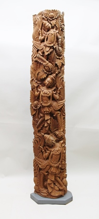 A SUBSTANTIAL 20TH CENTURY FAR EASTERN CARVED WOOD PANEL, decorated with dancers amidst blooms, 199cm high