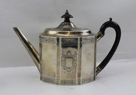 GEORGE SMITH & THOMAS HAYTER A GEORGE III SILVER TEAPOT, having engraved Heraldic device and band decoration, ebonised handle and knop, London 1796, weight 520g. (to include non-silver fittings)
