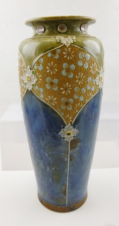 A ROYAL DOULTON STONEWARE VASE having blue mottled body with green mottled shoulders, tube lined and impressed floral decoration, impressed marks to base include the reference number 8347, 36cm high