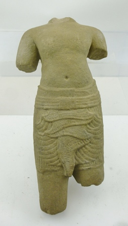 A 12TH CENTURY CARVED STONE TORSO FROM ANKGOR WAT, the temple complex in Cambodia, originally constructed as a Hindu temple of the god Vishnu for the Khmer Empire, (provenance - purchased by our vendor from a Danish Diplomat in New York who had worked in Southern Asia in the 1960s/70s, 32cm high