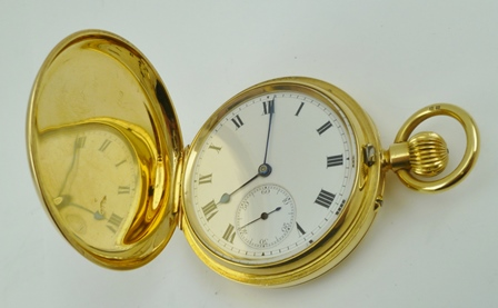 AN 18CT GOLD CASED GENTLEMANS HUNTER POCKET WATCH fitted ring suspension, the enamel dial with Roman numerals and secondary dial