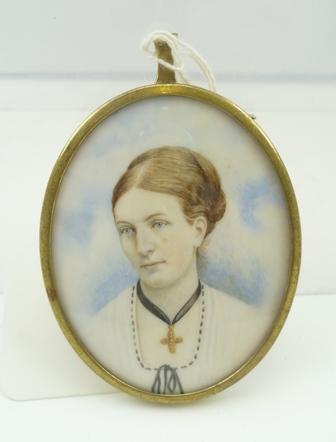 A 19TH CENTURY OVAL MINIATURE PAINTING ON IVORY, sitter is Dora Broughton, daughter of Capt William Broughton RN, see inscription verso, in brass oval mount frame, 7cm x 5.5cm