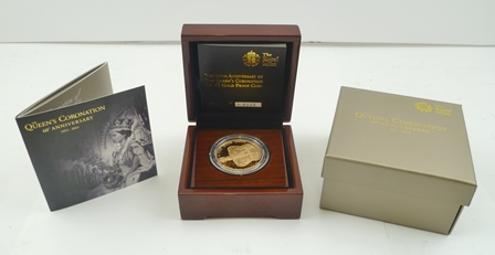 THE ROYAL MINT A limited proof edition £5, 22ct gold coin, a presentation piece in polished wood box, with certificates, no.223 of 2000, weight 39.94g