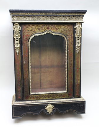 A 19TH CENTURY FRENCH EBONISED AND BOULLE WORK PIER CABINET, having ormuolu mounts, fitted single glazed door, 118cm high x 83cm wide