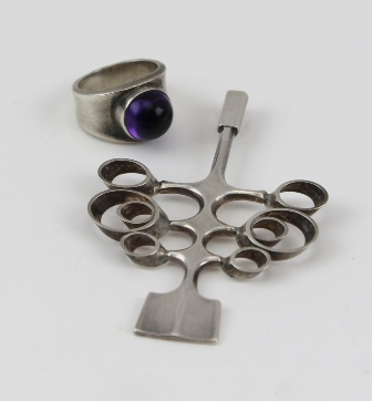 A GEORG JENSEN SILVER RING set with a cabochon amethyst, together with a SILVER DAVID ANDERSEN NORWEGIAN TREE DESIGN PENDANT (2)