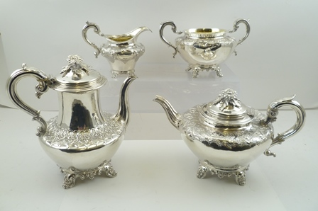 A MATCHED SILVER TEA AND COFFEE SET comprising; a Victorian teapot, milk jug and two-handled sugar bowl, with a William IV coffee pot. The tea and coffee pot both have scrolling acanthus thumb piece handles and floral knops to the hinged covers. Thecoffee pot is by Edward, Edward Junior, John and William Barnard, London 1831. The teapot is by Henry Holland, London 1859. The sugar bowl is by Joseph Angell I and Joseph Angell II, London 1847 and the milk jug is by Richard Pearce and George Burrows, London 1840, combined weight 2,213g