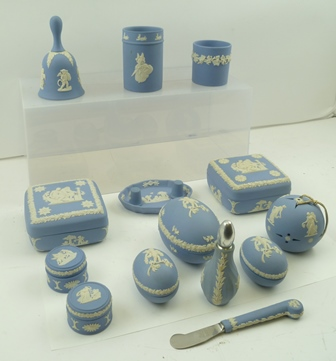 A COLLECTION OF WEDGWOOD CERAMIC TRINKETS, pale blue ground, cameo decorated, includes dressing table boxes, hand bell, atomiser etc. (15)