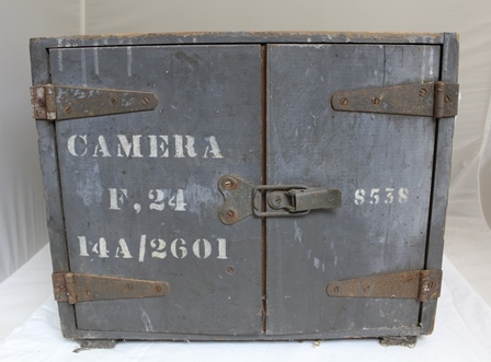 An A & M F24 ex RAF AERIAL RECONNAISSANCE CAMERA with high speed operation and attachments in original wooden crate marked F24 14A/2601, including motor unit Ref: 14A/535 Serial No: CM2/7444/12 V DC, high speed gearbox Ref: 14A/2055 Serial No:s564 and magazine film Ref: 14A/730 No.1 equipment Serial No: 2880. (Developed by Royal Aircraft Establishment at Farnborough inb 1925 and used ion Spitfires and other reconnaissance planes in WW II).