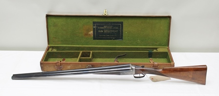 ARMY & NAVY A 12-BORE BOXLOCK NON-EJECTOR SHOTGUN by Army & Navy, no.69462, border engraved action with figured 15 stock, the 28 barrels with good bore diameter and wall thickness, in a canvas and leather fitted case with makers trade label (Shotgun Cert. required)