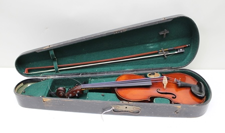 A FRENCH FULL SIZE VIOLIN (circa 1900) having red/brown varnish and one piece 14.125 back (excluding button) bears interior label Antonius Stradivarius 1700, together with silver mounted and mother of pearl inlaid bow, in black coffin style case