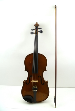 AN EARLY 20TH CENTURY AUSTRIAN VIOLIN having golden reddish brown varnish and two piece back, bearing interior paper label Joannes Baptist Havelar, Fecit Wien Anno **** (possibly 1926), 14.125 back (excluding button), together with a nickel mounted bow