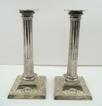 HARRISON BROTHERS & HOWSON A PAIR OF LATE 19TH CENTURY SILVER CANDLESTICKS of classical column form, on squared scallop raised bases, Sheffield 1899, 25.5cm high