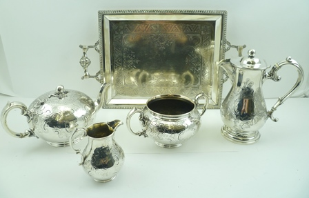 EDWARD & JOHN BARNARD A MID 19TH CENTURY THREE PIECE SILVER TEA SERVICE, the teapot having a melon knop to the hinged cover, together with the two-handled sugar and a cream jug, London 1855, combined weight 1142g and a MATCHED SILVER HOT WATER POT,Birmingham 1923, 583g (total silver weight for the lot - including non-silver heat resisters on the handles - 1725g), together with a SILVER PLATED TRAY of rectangular form, having mask cast handles
