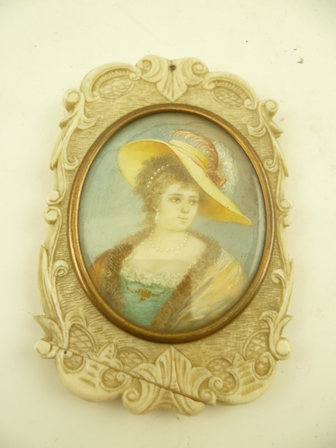 A 19TH CENTURY CARVED IVORY SLIDING VANITY MIRROR with inset miniature painted portrait of a lady, 10cm x 7cm