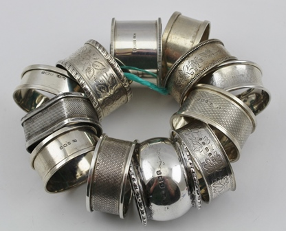 TWELVE VARIOUS SILVER SERVIETTE RINGS, combined weight 170g