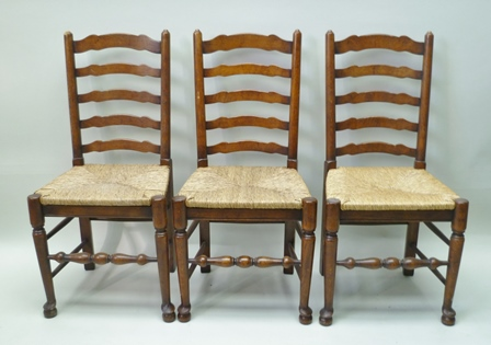 A SET OF SIX PROVINCIAL LADDER BACK SINGLE DINING CHAIRS, raised on turned fore supports with turned front stretchers, drop-in seagrass seats
