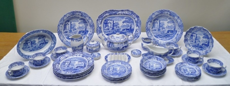 A COMPREHENSIVE COLLECTION OF SPODE, ITALIAN DESIGN, TRANSFER PRINTED, COBALT BLUE TABLE CERAMICS comprising; six of each - dinner plates, dessert plates, side plates, small bowls, cups, saucers, butter pat dishes, 2 large serving bowls, 1 fluted serving dish and one of each - meat platter, oval serving dish, gravy boat and saucer, teapot, ashtray, toast rack, lidded sugar bowl, milk jug, small cream jug, in all approx. 55 pieces