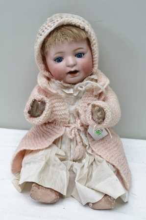 A JAPANESE BENT LIMBED BABY DOLL, circa 1915-1922  dressed in pink from the import house MORIMURA BROTHERS. (acquired in New City around the time of the First World War)