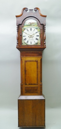 AN EARLY 19TH CENTURY OAK LONGCASE CLOCK, the arched painted dial with hunting scene decoration, named John Thomas Newcastle Emlyn, with Roman numerals, having 8-day movement, the hood with swan neck pediment, column mounted, 127cm high