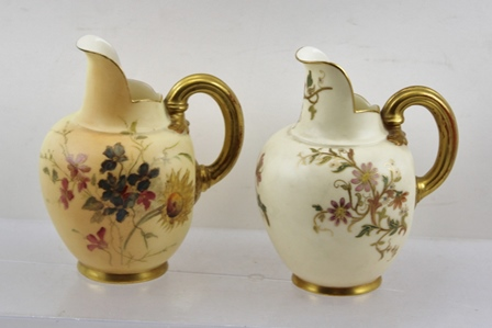TWO ROYAL WORCESTER VICTORIAN PORCELAIN CARAFE JUGS, one white glaze, the other blush ivory, each with polychrome decoration and gilt handle, model 1094, date codes 1892 & 1898, 135mm high
