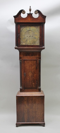 AN EARLY 19TH CENTURY OAK LONGCASE CLOCK with swan neck hood, the brass dial engraved John Way of Newton St Loe, Roman hours, eight-day striking movement, inlay to door, on bracket feet, 194cm high