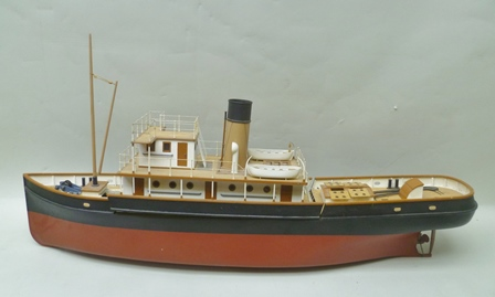 A WELL MODELLED, DIE CAST AND TIMBER STEAMSHIP, gas fired brass steam boiler concealed within the central removable deck section, the upper deck has single funnel, two tier bridge, boats and other accessories, overall length bow to stern 110cm, overall height to top of funnel 40cm
