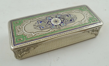 A LATE 19TH CENTURY FRENCH SILVER AND ENAMEL SNUFF BOX, engine turned decoration, the cover inlaid with blue and green, gilded interior, 8cm wide