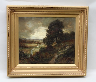 R**W** BATES Sheep on a hillside path with distant view of a river meadow, humped back bridge and dwelling, with stormy skies above, an early 20th century Oil on canvas study, signed and dated 1906, 49cm x 60cm, in period moulded gilded frame