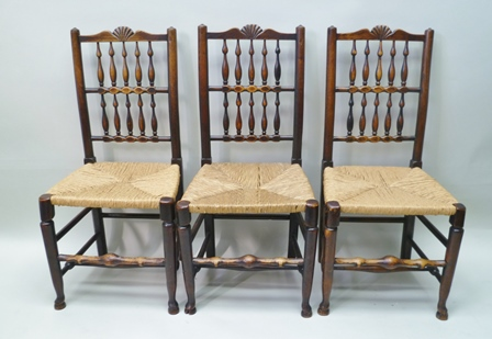 A SET OF SIX LATE 19TH CENTURY SPINDLE BACK SINGLE DINING CHAIRS, scallop crest rails, woven rattan seats with turned supports and stretchers