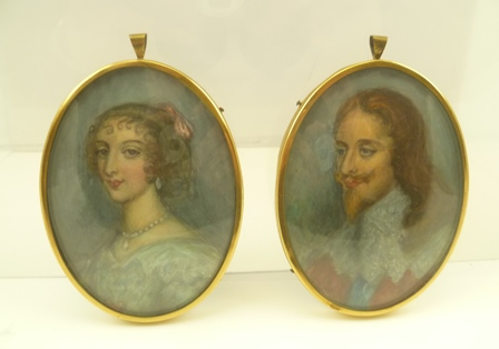 A PAIR OF ENGLISH SCHOOL PORTRAIT MINIATURES King Charles I and Queen Henrietta, Watercolours, 9.5cm x 7cm, in oval brass frames with ring suspension and convex glass