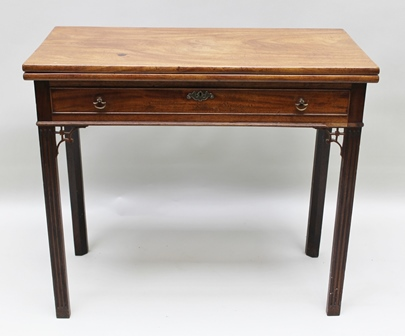 A GEORGE III MAHOGANY FOLD OVER TEA TABLE, fitted drawer on moulded squared supports, 83cm wide