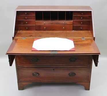 A GEORGE III MAHOGANY FALL FRONT BUREAU, fitted interior, brass handles, fitted three drawers on bracket feet, 99cm wide x 107cm high