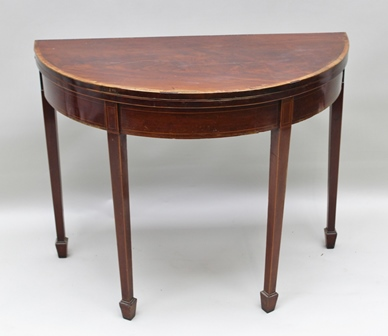 A REGENCY MAHOGANY DEMI-LUNE FOLD OVER CARD TABLE, raised on squared tapering spade foot supports, 96cm wide
